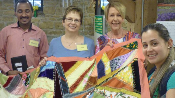 group-with-quilt